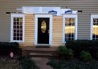 Porch Roof Removed and Siding Replaced